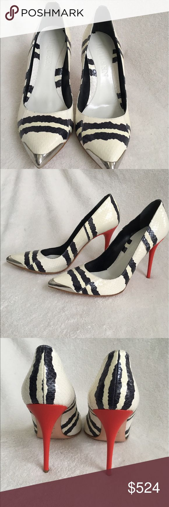 Alexander McQueen black and ivory snake pumps Stunning Alexander McQueen black and ivory snake pumps with red heels. It was originally $1070 and went on sale for $749 and is now selling for another 30% off!!! Only tried on in store and never worn otherwise. It is in great condition. Comes with its original box.     **No trade** Alexander McQueen Shoes Heels