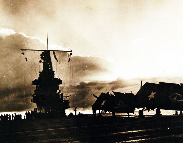 Operation Torch, November 1942. Sunset over French Morocco on the evening of the day Allied forces invaded North Africa. Dark in the gathering gloom, planes of U.S. aircraft carrier seem to rest beneath their wings on the flight deck of their ship. Photograph released October 27, 1943. Official U.S. Navy Photograph, now in the collections of the National Archives.