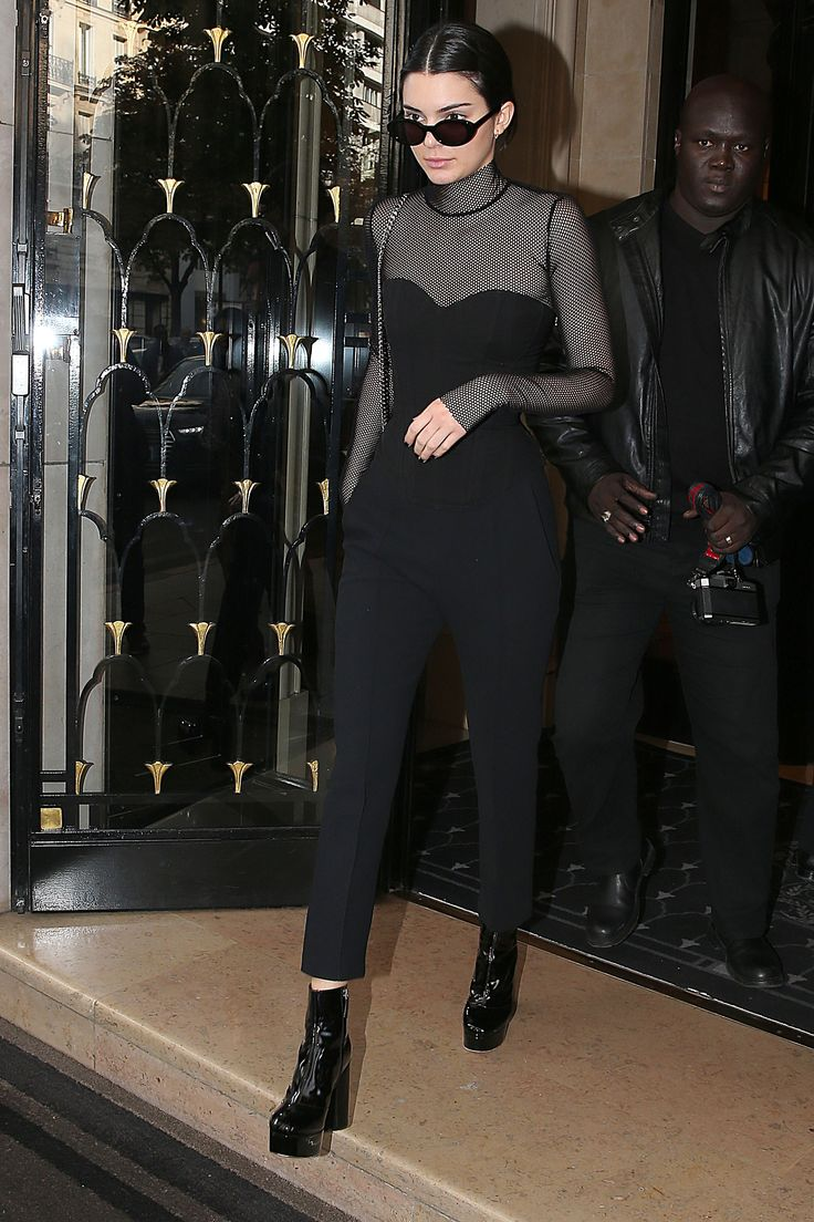 October 3, 2016 In a mesh turtleneck and corset top, black trousers, platform patent-leather booties and black sunglasses in Paris.