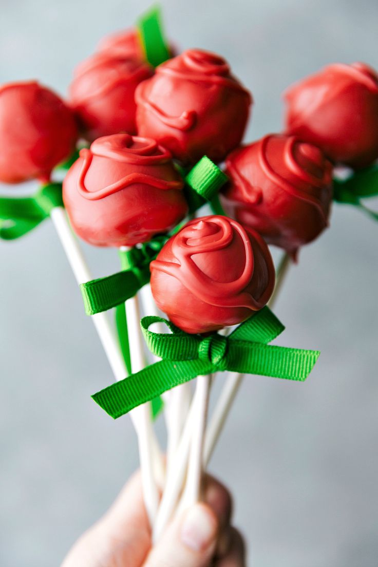 """Four simple themed """"Flower Treats"""" that are perfect for Mother's Day or Spring celebrations! Rose Cake Pops, Lemon Curd Cookie Cups, Flower Cookie Pops, & Sunflower Nutella Frosting Bites. via chelseasmessyapron.com"""