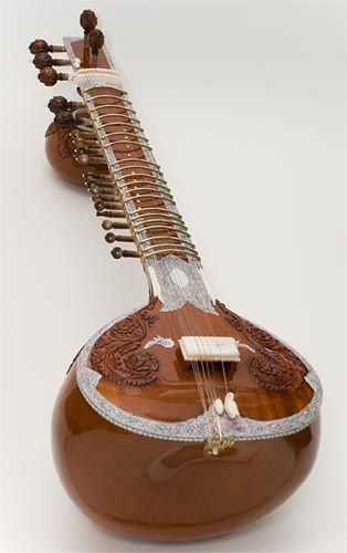 Indian plucked string sitar, which derives its distinctive timbre and resonance from sympathetic strings, bridge design, a long hollow neck and a gourd resonating chamber