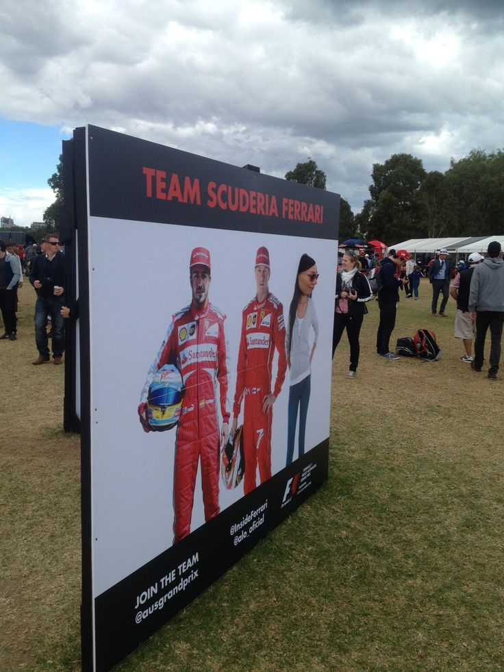 Ferrari had these cut outs where fans could put their face on the race driver. Nice photo op!