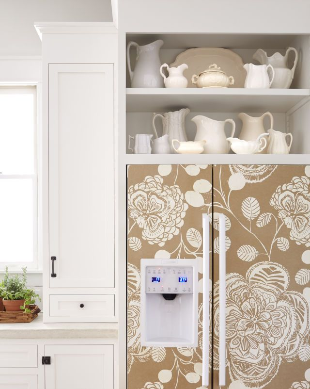 To warm up the white refrigerator, Lauren applied wallpaper with wallpaper paste and, for water-resistancy, sealed with polyurethane.