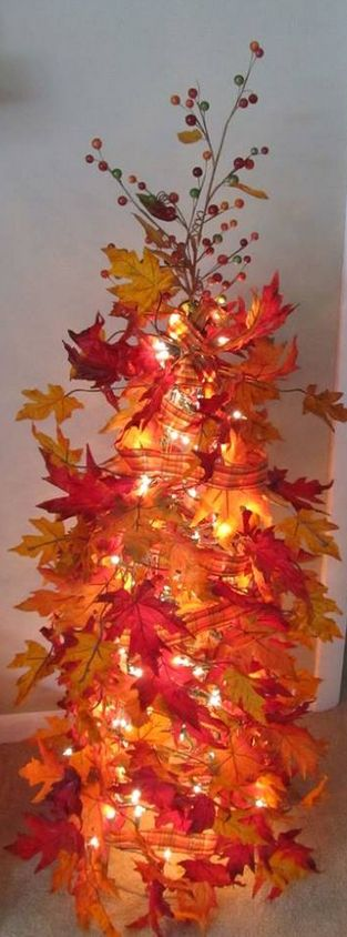 make a fall tree! It is as simple as a tomato cage, Christmas Lights, fall ribbon, and what ever you want on the top!