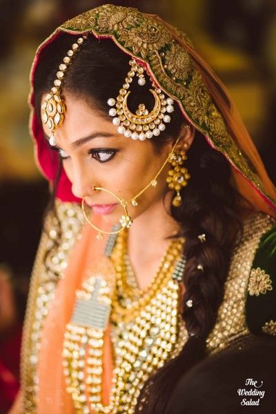 Indian bride wearing bridal lehenga and jewelry. #IndianBridalHairstyle #IndianBridalMakeup #IndianBridalFashion #BridalPhotoShoot Bridal Jewellery Designs | Polki, Kundan, Gold and Diamond | Wedmegood