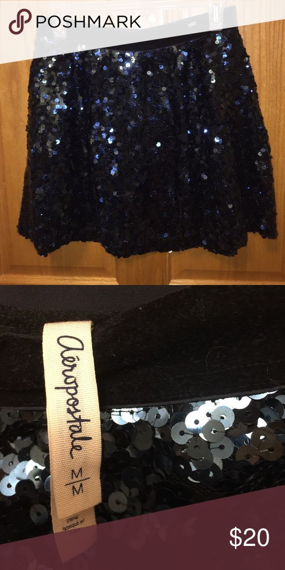Aeropostale sequin skirt Medium, dark blue, sequin Aeropostale skirt. Black slip under the sequin layer, attached at the band. Good condition, only worn a couple times. Aeropostale Skirts Mini