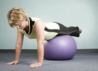 Workout with Pilates Ball Exercises: Plank to Push Up on the Ball