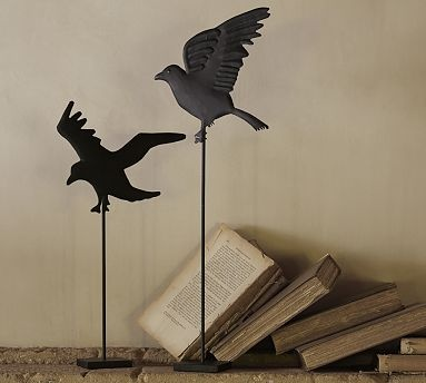 ominous crows take flight atop slender elevated stands arrange candles or other decorative objects around the bases for a layered halloween display - Halloween Crows