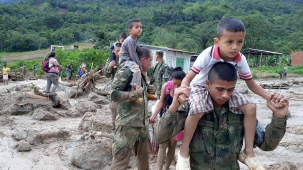 Colombia's security forces are searching for hundreds of missing people after mudslides left more than 200 dead on Saturday. About 1,100 soldiers and police are involved in the rescue effort. Heavy rain flooded the city of Mocoa in the country's south-west with mud and rocks, burying whole neighbourhoods and forcing residents to flee their homes. … Continue reading Colombia landslide: Rescue teams race to reach survivors →
