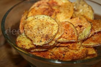 Homemade Baked Potato Chips - Thinly cut, red skin potatoes, tossed with olive oil and a variety of seasonings and baked.