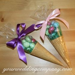 Easter wedding favor idea using cellophane cone bags, mini chocolate Easter eggs, sugar cones, and double-faced satin ribbon. Wedding & event supplies -  www.yourweddingcompany.com