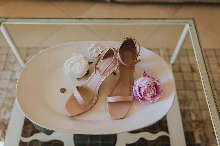 Lovely blush bridal shoes with the bride's lucky sixpence. Photo by Benjamin Stuart Photography #weddingphotography #weddingshoes #blushshoes #sixpence #italianwedding #bride #weddingday
