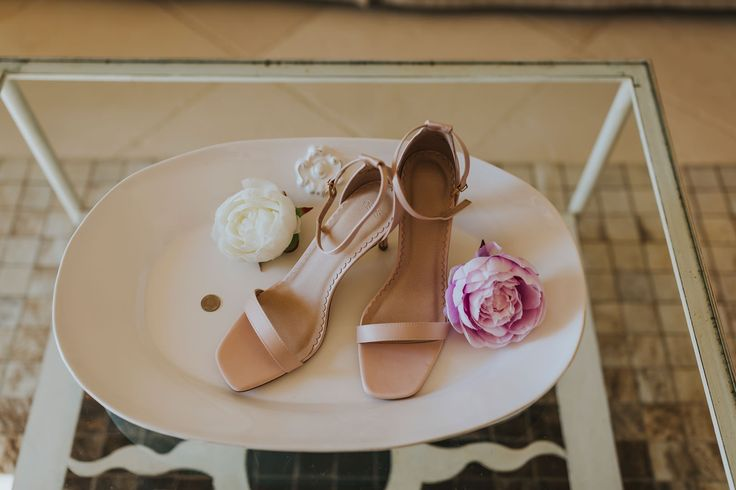 Lovely blush bridal shoes with the bride's lucky sixpence. Photo by Benjamin Stuart Photography #weddingphotography #weddingshoes #blushshoes #sixpence #italianwedding #bride #weddingday