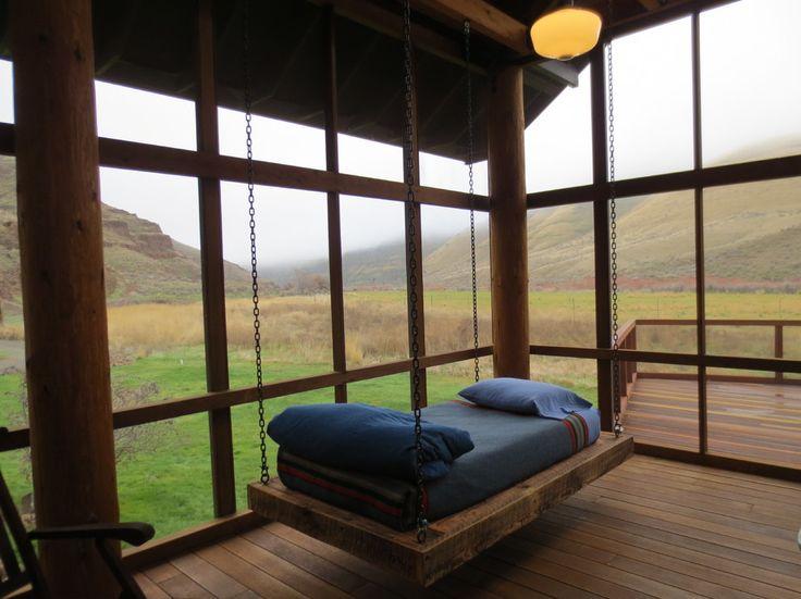 Rustic single swing bed in a minimalist room