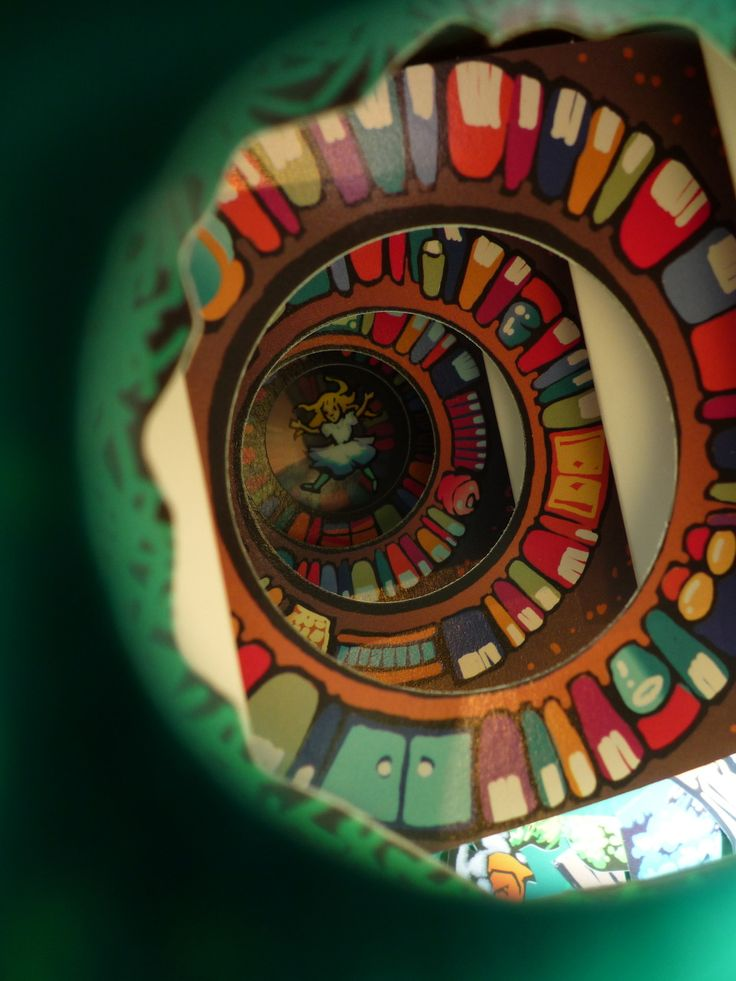 The view from down the rabbit hole in Robert Sabuda's Alice in Wonderland pop-up book. You pull this part out of the book and it has an accordion affect, and you look down the center. Very cool.