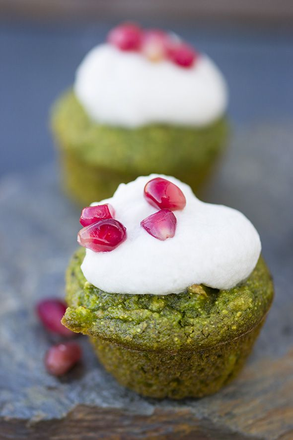 Wholesome green spring muffins topped with coconut whipped cream & pomegranate.