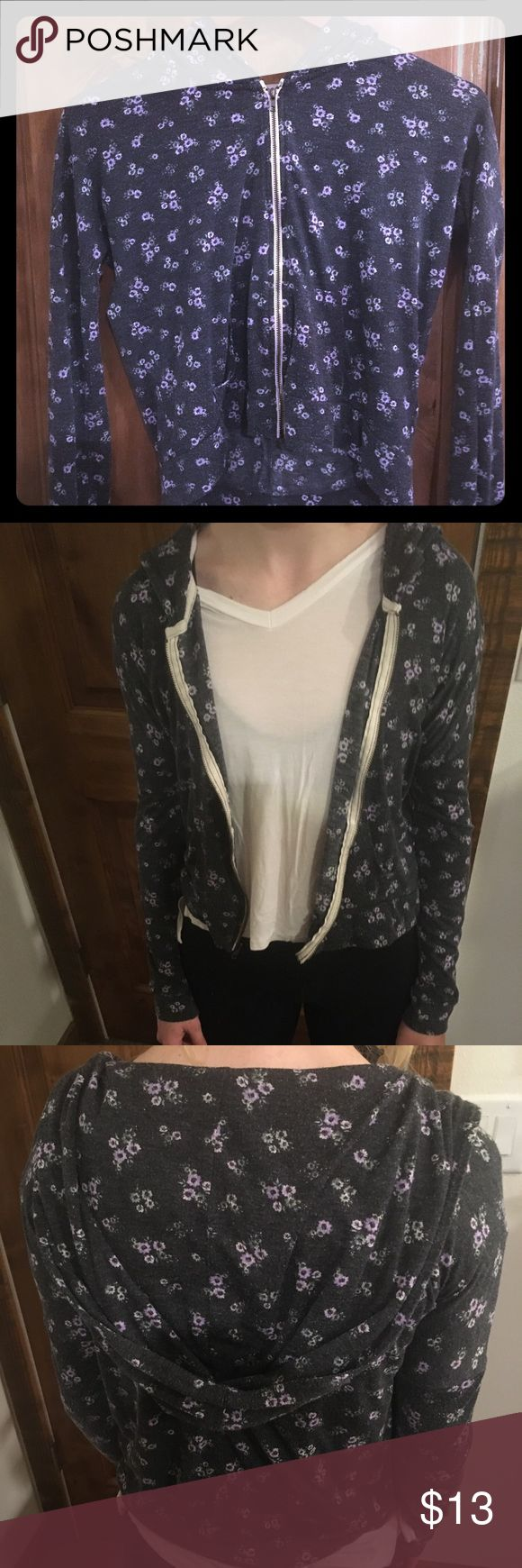 Abercrombie kids floral zip up thin hoodie. Cute zip up with very slight wear on the fabric. Could fit an XS women size but it is a kids medium. Zipper is fully functional. abercrombie kids Shirts & Tops Sweatshirts & Hoodies