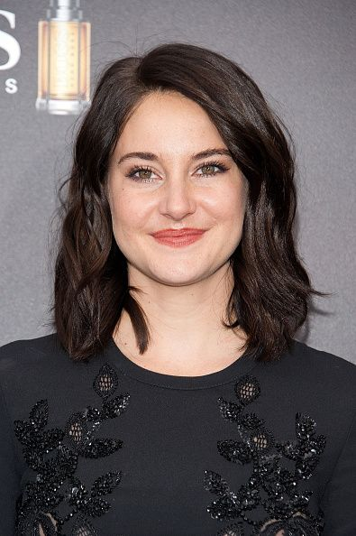 25 Best Brown Hair Color Ideas - Brunette Celebrities Hair Shades - Shailene Woodley - The Divergent star decided to switch it up with a dark black-brown shade and natural waves. Don't know about you, but we're loving this look just as much as the pixie. Click through redbookmag.com for more celebrity hair inspiration.