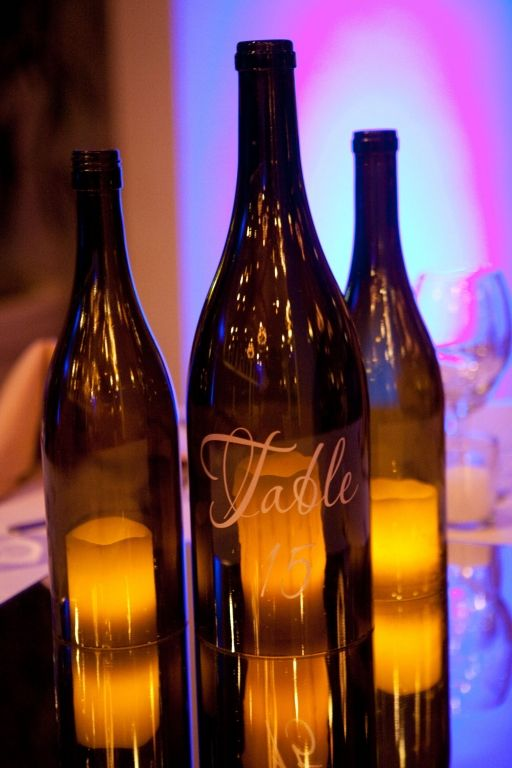 Need to make these! Ruffled®   See ads - Wine Bottle Centerpieces - Reception