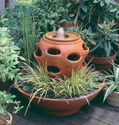 Planter Fountain. In This Simple Homemade Fountain, An Azalea Container  Supports A Strawberry Pot