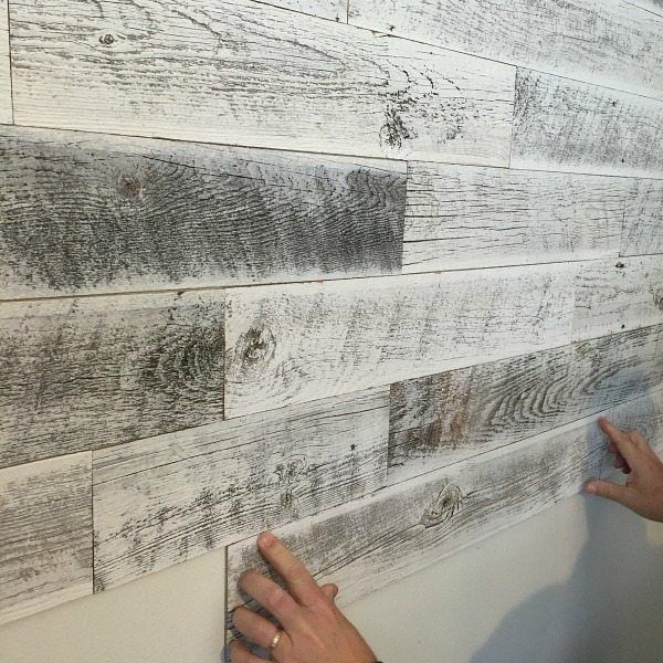 Farmhouse wall treatment with weathered white wood is easy to apply with Stikwood, real wood! You can complete this project in no time!