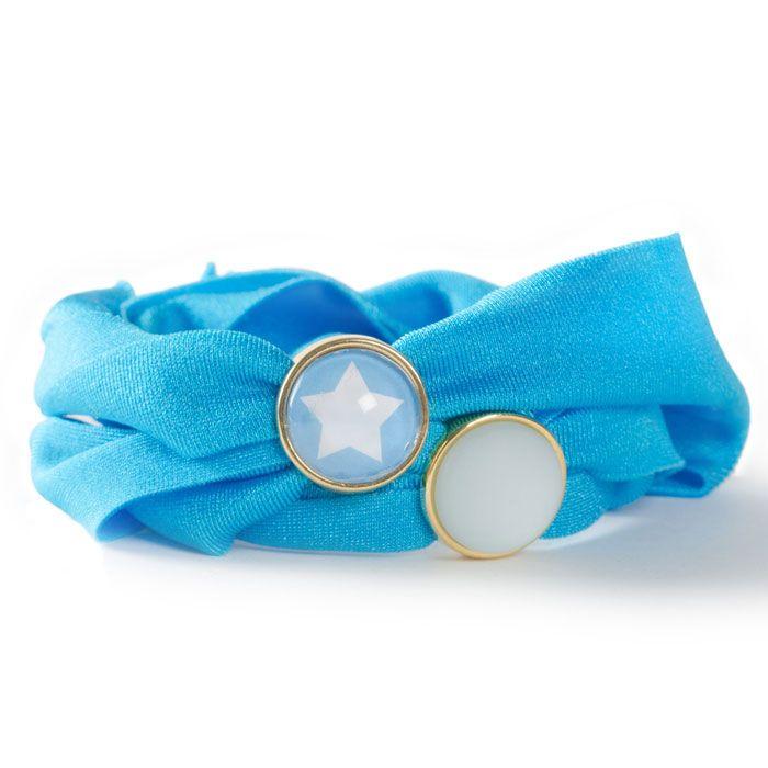Armband aus Lycraband, Sliderperlen, Polariscabochons, Glascabochons und Motivbögen von Glücksfieber.