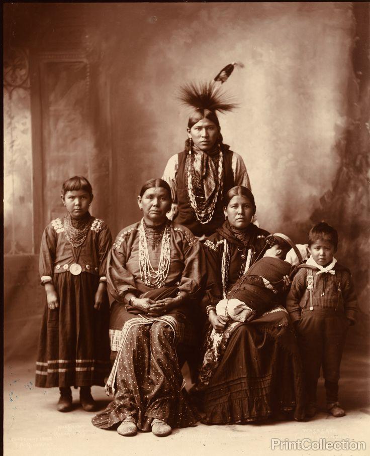 Sauk Indian family, full-length portrait taken by F.A. Rinehart, in Omaha, Nebraska, January 3 1899.