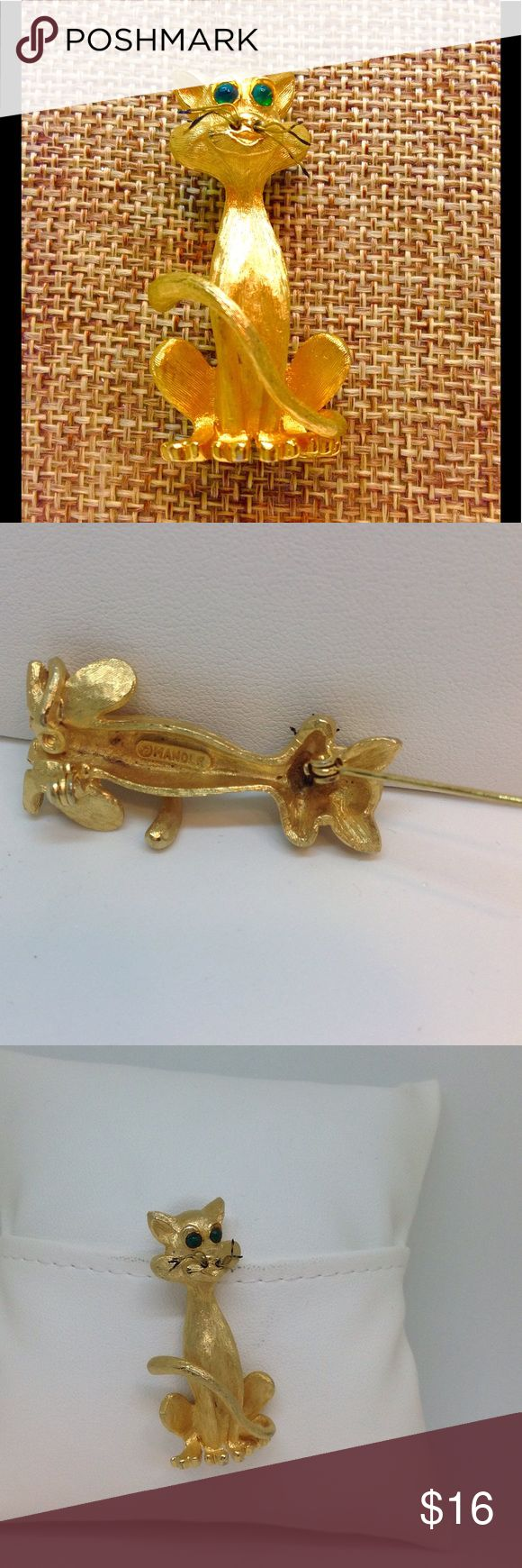 "Designer Mandle Cat Brooch Brush Gold Emerald Eyes Vintage Brooch in Pristine Condition with Rollover Clasp.  Body is brushed gold, toes are polished look.  Whiskers are made of tiny wires with black and touch of gold.  Measures 1-3/4"" X 1"". Mandle Jewelry Brooches"