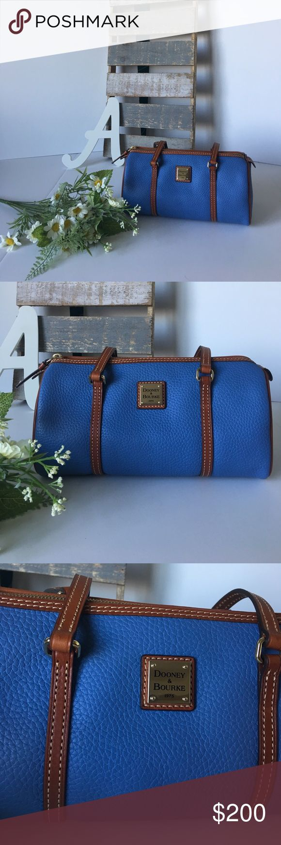 Dooney & Bourke Sky Blue Barrel Bag Authentic Dooney & Bourke Sky Blue Barrel Bag! Comes with registration number. When you get your registration number you fill out your information with the bag. Brand new with tags. Really great quality. Dooney & Bourke Bags