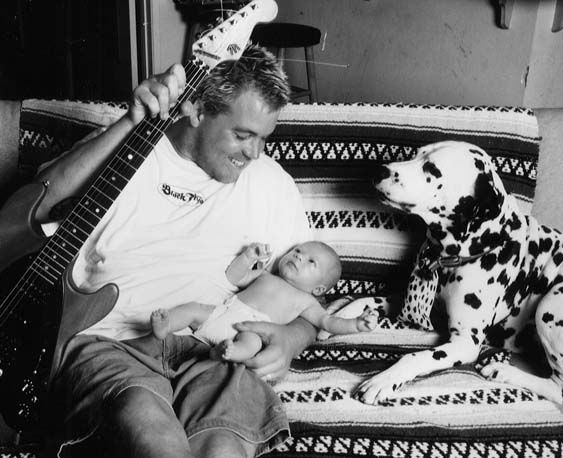 Bradley Nowell- vocalist of Sublime and a musician who left this world WAY too early!!!! Here with his baby and Lou Dog