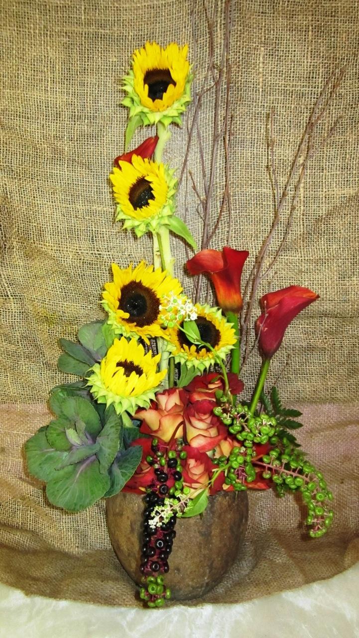 Sunflowers, calla, kale, roses, poke berry, birch branch