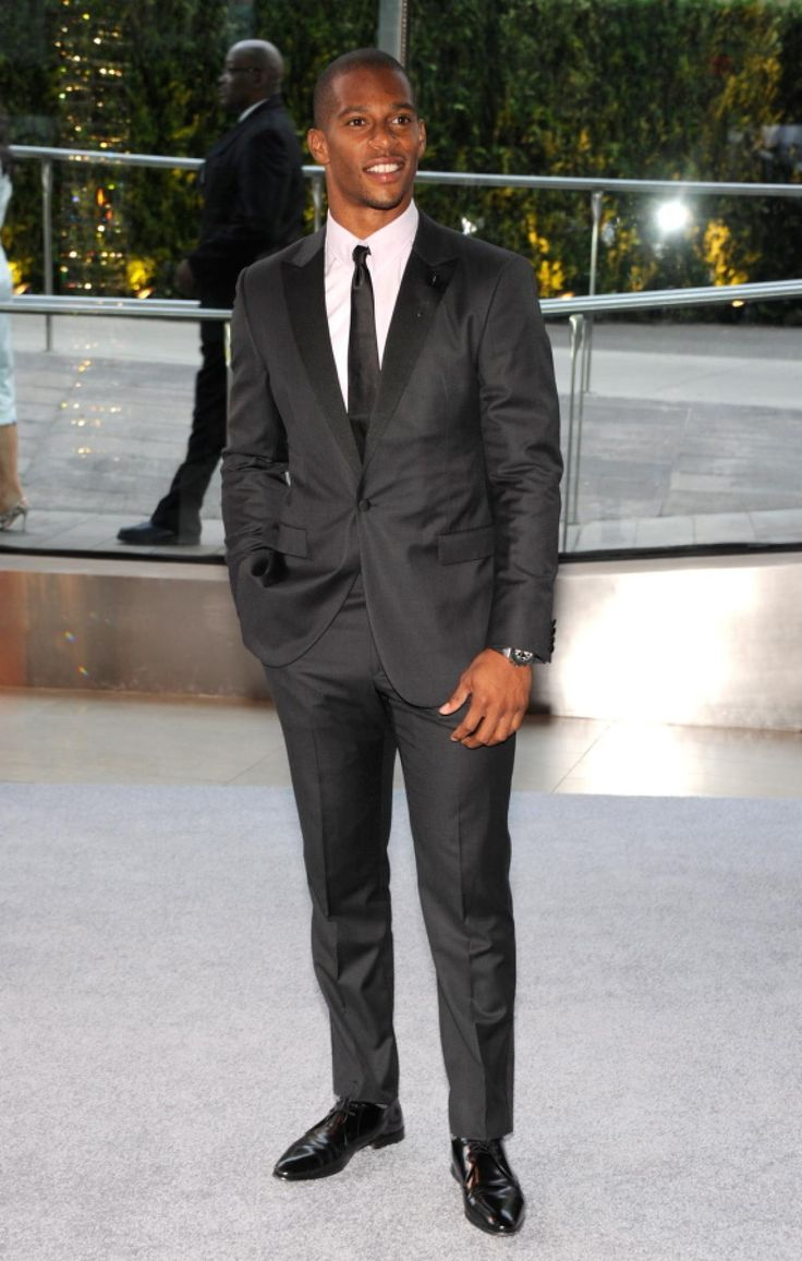 Victor Cruz Wearing Black Suit White Dress Shirt Black Leather Derby Shoes Black Silk Tie