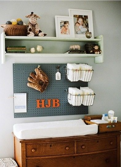 Cute idea but I could see a toddler pulling everything off peg board daily.  * move peg board away from changing table, could do construction theme or sports theme