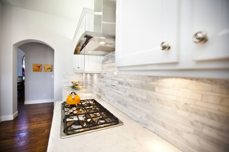 Beautiful light grey tile splashback.