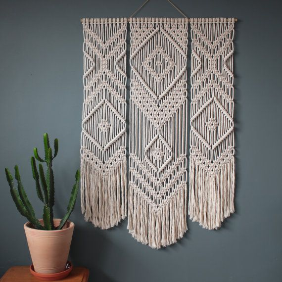 This macrame wall hanging is handmade using 100% cotton cord (4.5mm) in natural ecru with a bamboo supporting rod.  Dimensions - Bamboo Width: