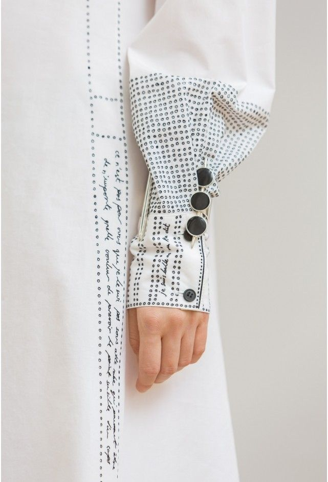 Embroidered sleeve detail with words & dots; sewing; textiles; creative fashion design detail // Lemaire