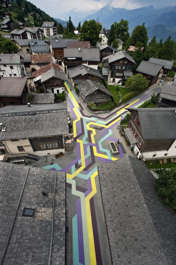 Every summer artists are invited to come to the Swiss village of Vercorin and create artwork that unites the village. In 2010 Lang/Baumann were given the task, and they decided to paint the roads bright colors to contrast the old historical architecture of the town. Children used these bright colored stripes to skate, run and bike on.