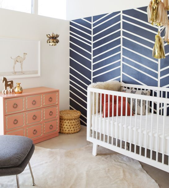So much to love: navy herringbone accent wall, pink dresser and the darling camel art print!