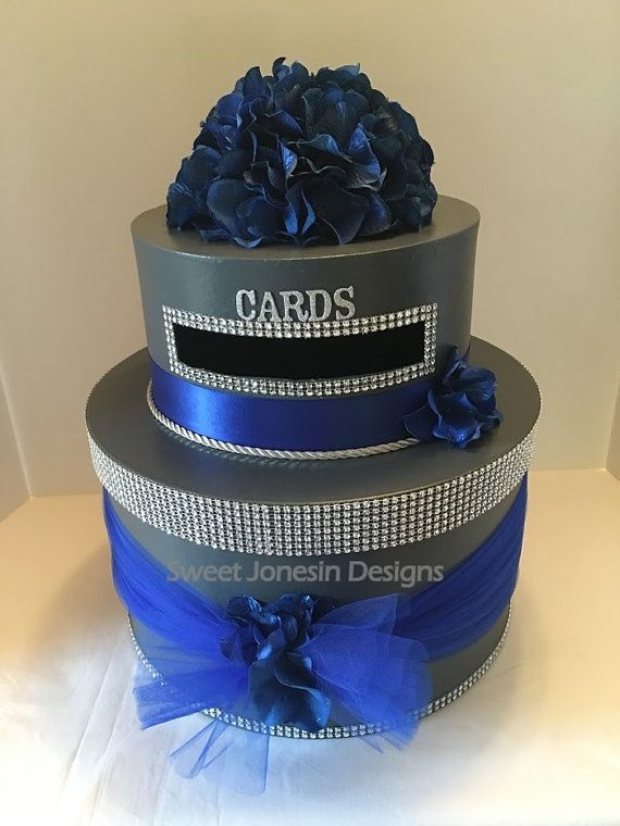 **Made to Order**  This 3 Tier Wedding Card Box is silver with royal blue hydrangeas on the top tier. This box is accented with silver diamond mesh ribbon and royal blue tulle.  The box size is 16 in X 10in and holds up to 200 cards.  This 2 tier design can be custom made in your wedding colors.  Card Boxes are a beautiful addition to every wedding reception and can be used at the bridal shower, wedding reception and then as storage for wedding card and mementos. After your wedding or event…