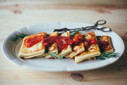 rosemary ricotta blintzes w/ strawberry rhubarb glaze