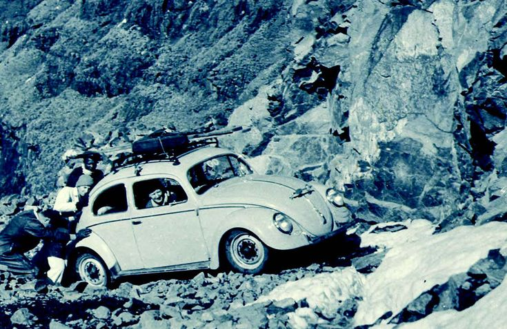 """In 1956, the twin-spoor Sani Pass was accessible only by donkey, Land Rover or Willys Jeep. But that didn't stop four intrepid adventurers from tackling the dangerous pass – in winter, with snow lining the track – in a 1,2-litre, rear-wheel-drive Volkswagen Beetle, generally referred to as """"The Bug""""."""