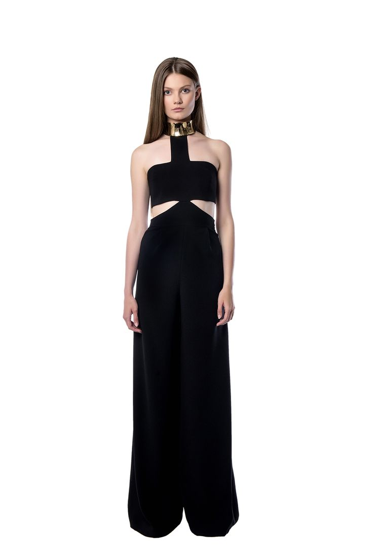 Floor - skimming flared jumpsuit  A floor – skimming black flared jumpsuit created from black crepe, detailed in the neckline with a metallic accessory. The piece is designed to highlight your bust with the side cutouts. We best like it with gold type accessories, sandals and a tote.