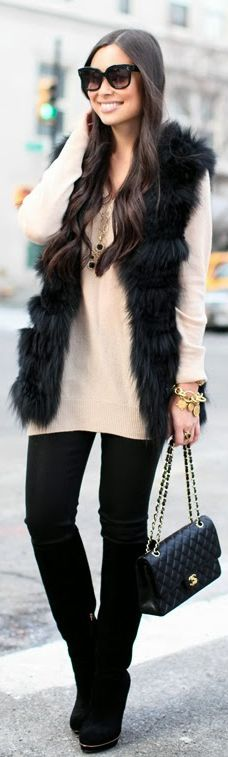 Black stretch pants, neutral sweater, black faux fur vest, high black boots or pumps, black purse and gold accessories.