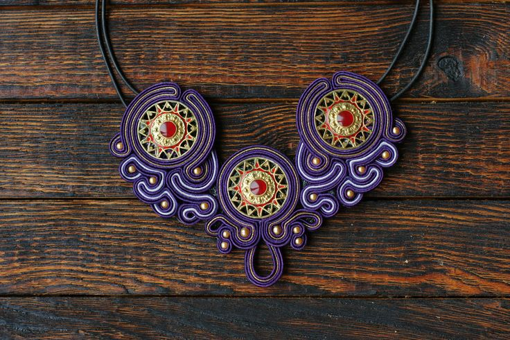 A personal favourite from my Etsy shop https://www.etsy.com/listing/269434895/purple-soutache-statement-necklace