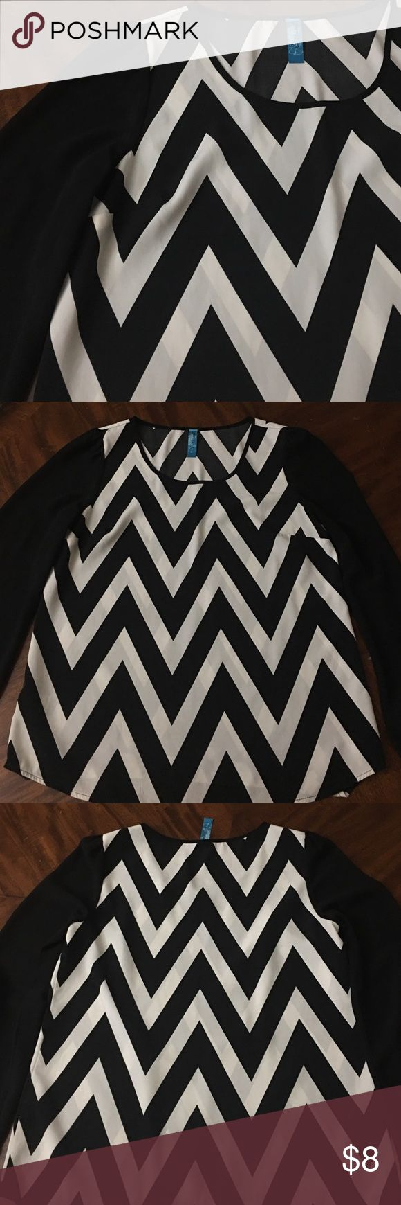 Francesca's Chevron Top Black and white chevron top from Francesca's. Sleeves are sheer and top is in like new condition. 30% off of bundles of 2 or more! Francesca's Collections Tops