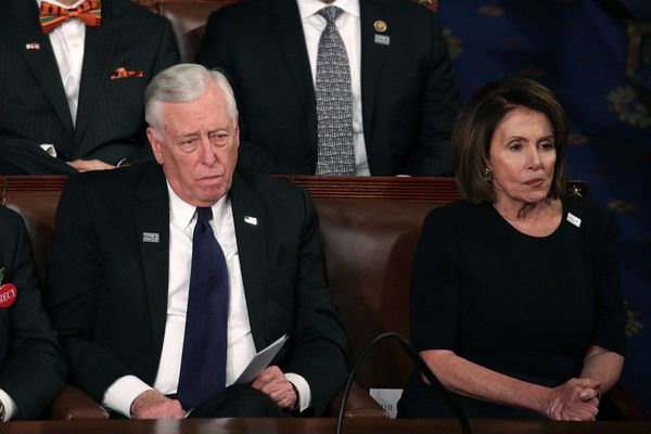 Nancy Pelosi Photos - U.S. Rep Steny Hoyer (D-MD) and U.S. House Minority Leader Nancy Pelosi (D-CA) watch during the State of the Union address in the chamber of the U.S. House of Representatives January 30, 2018 in Washington, DC. This is the first State of the Union address given by U.S. President Donald Trump and his second joint-session address to Congress. - Trump Addresses the Nation in His First State of the Union Address to Joint Session of Congress