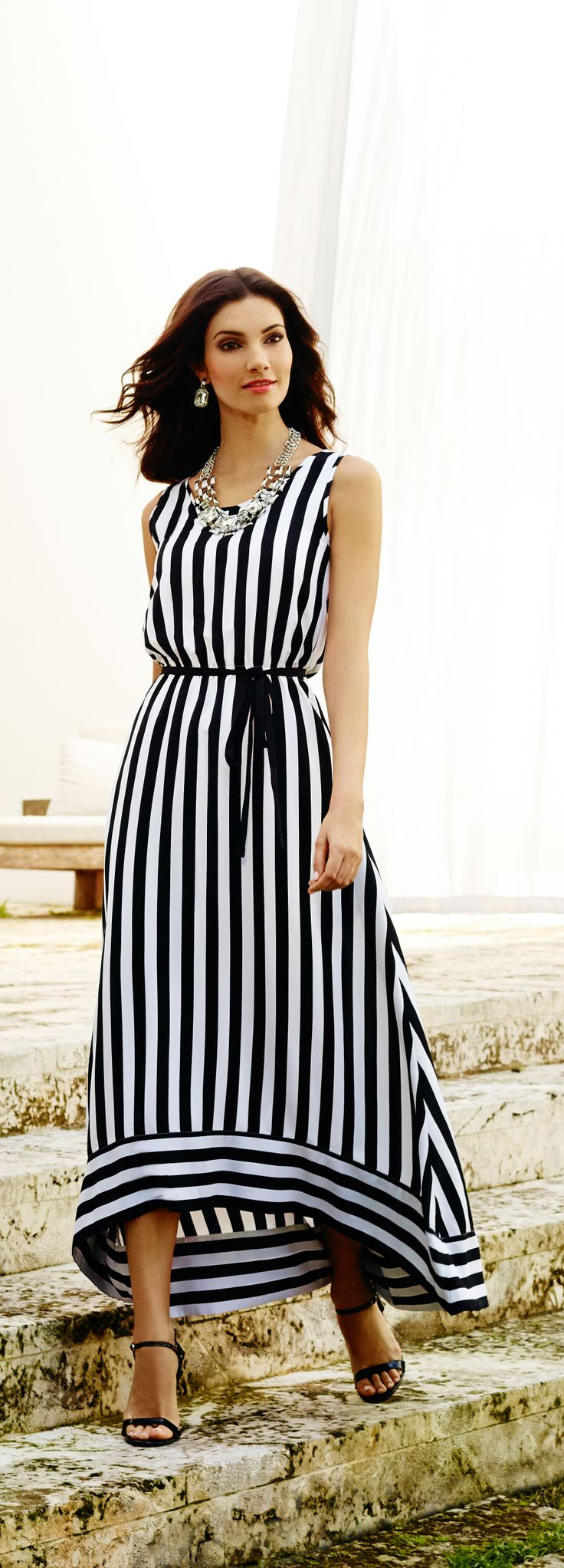 Black & white (and chic all over): Graphic stripes give the flowy high-low dress a bold makeover.