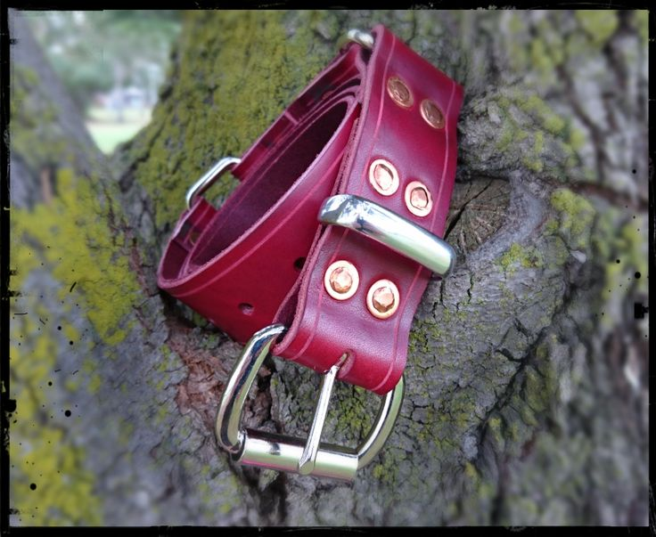 The burgundy red Italian leather of this rugged yet supple hobble belt contrasts beautifully with the 12 copper rivets and the steel fittings. The belt is at once a beautiful jeans/dress belt and also a set of bondage restraints. Visit the website to find out more.