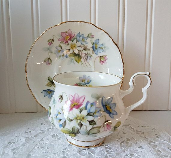 Pretty Byron, Royal Albert teacup & saucer from the Sonnet Series, 1983. The colors in the floral bouquet are in soft pastels of pinks, blues and white & gold trim on both pieces. The cup is unique in the Royal Albert Victoria shape with a rounder belly and ornate handle. The set is in