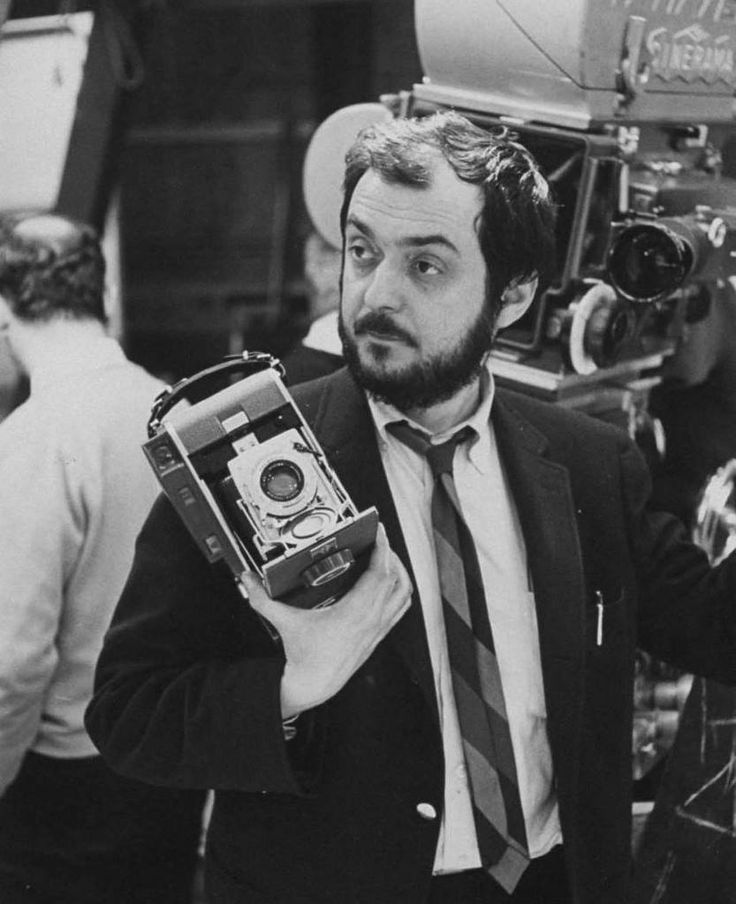 Film director Stanley Kubrick holding a Polaroid camera during the filming of 2001: a Space Odyssey.